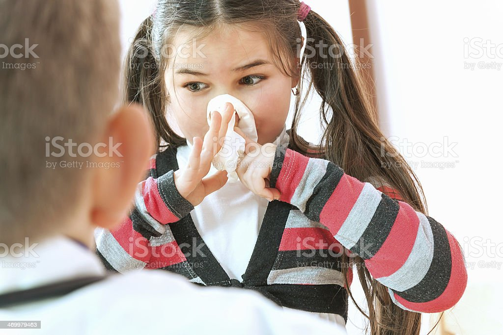 Sick little girl with a cold royalty-free stock photo
