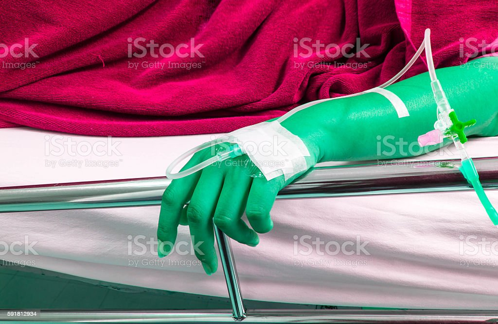 sick loved ones lying on a bed in the hospital stock photo