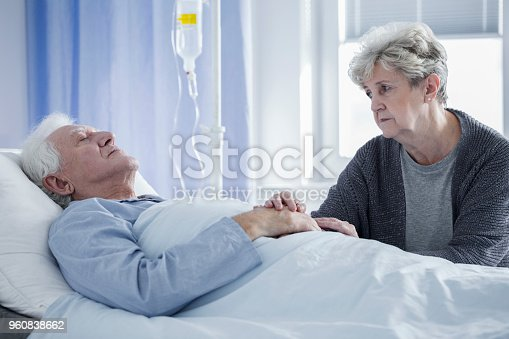 886711404istockphoto Sick man and worried wife 960838662