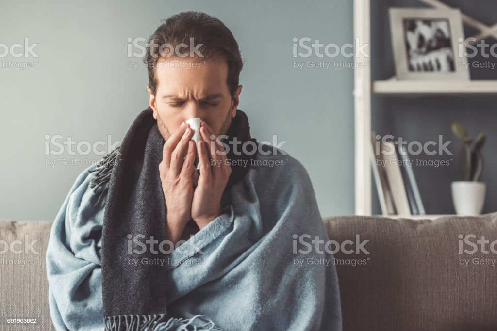 Sick man at home stock photo