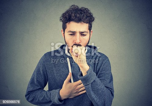 istock Sick man coughing with pain 926566576