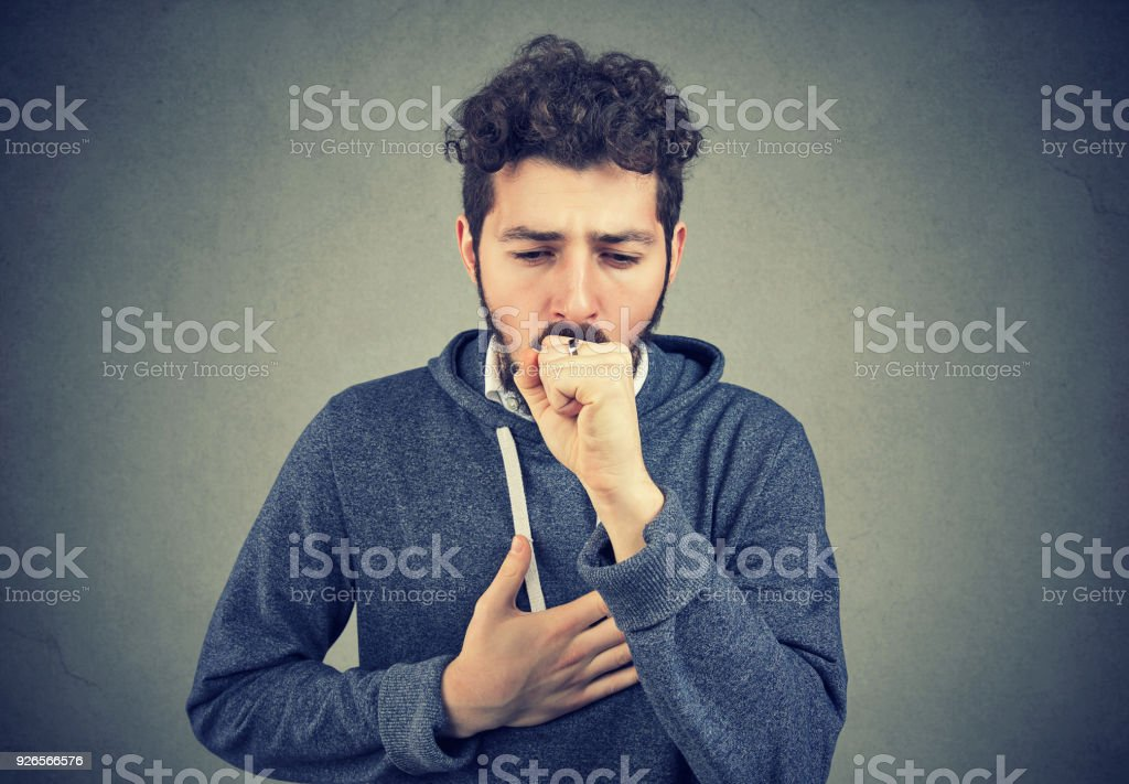 Sick man coughing with pain stock photo