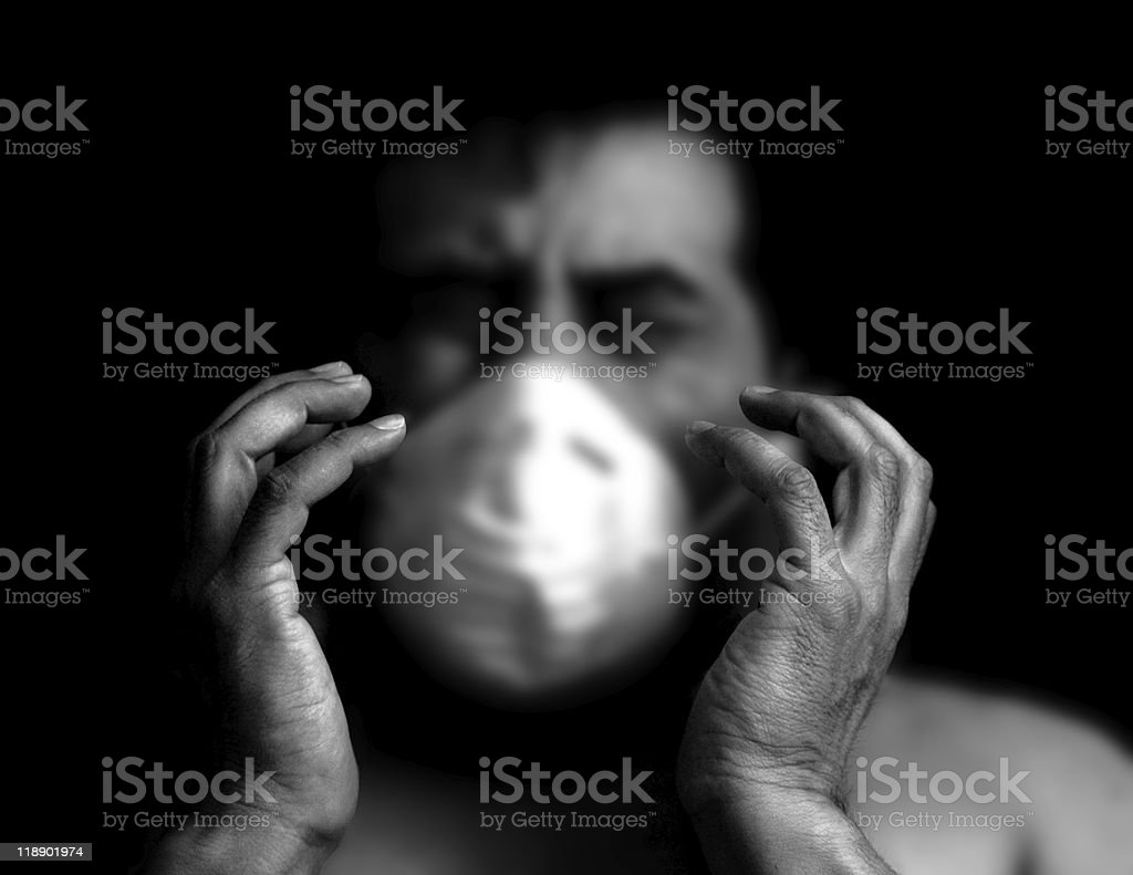 Sick man covering his mouth and nose with a mask royalty-free stock photo