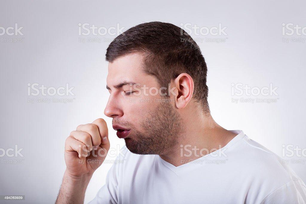 Sick man having a cough stock photo