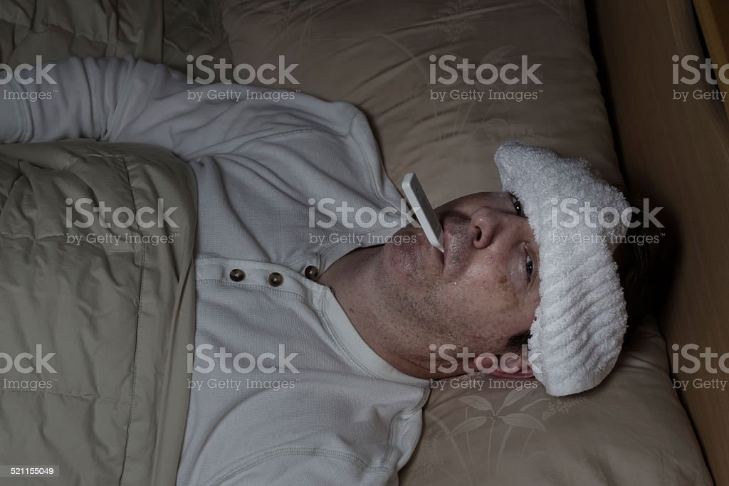 Sick Man in Bed stock photo