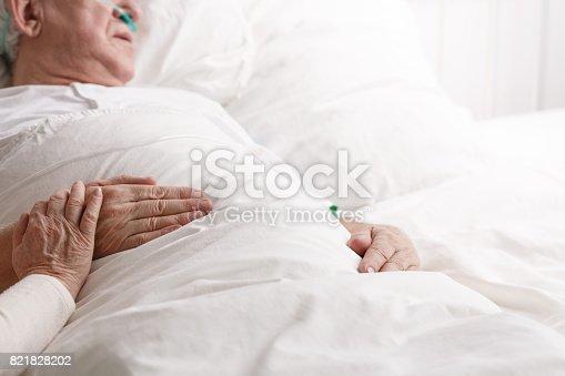 909569706istockphoto Sick man in hospital 821828202