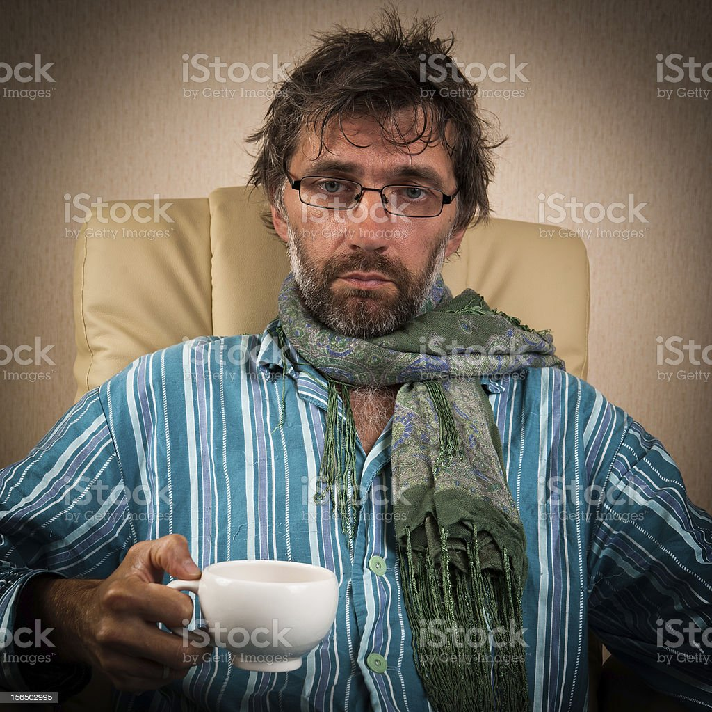 sick man sitting in chair with cup royalty-free stock photo