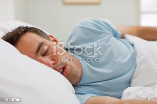 istock Sick man sleeping in bed 107429788