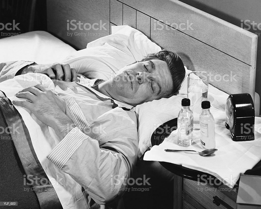 Sick man sleeping royalty-free stock photo