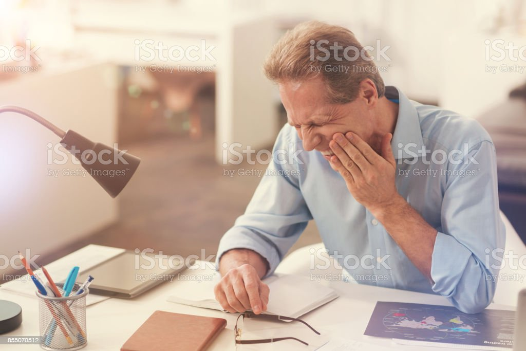 Sick man suffering from a toothache stock photo