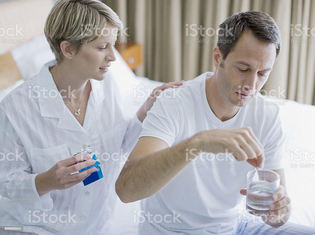 Sick man taking antacid royalty-free stock photo