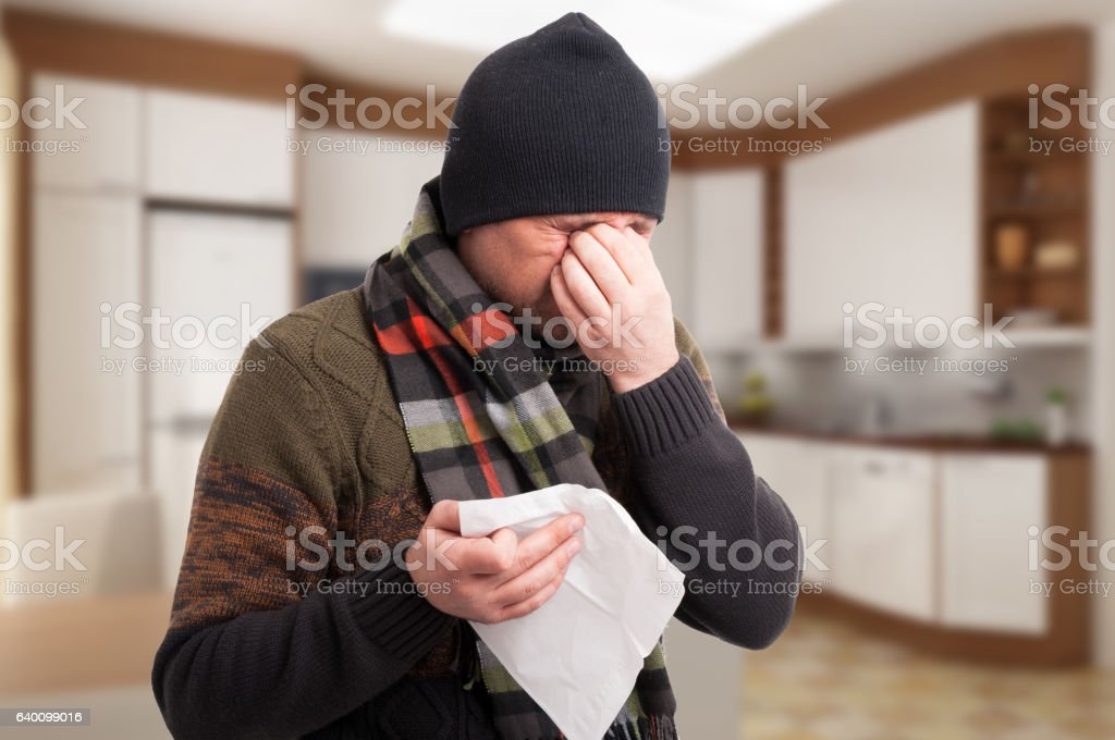 Sick man with nose congestion and headache stock photo