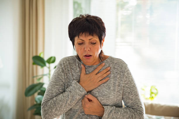 sick mature woman with sore throat - esophagus stock photos and pictures