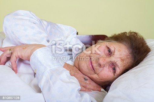 istock Sick old lady in bed 810857128
