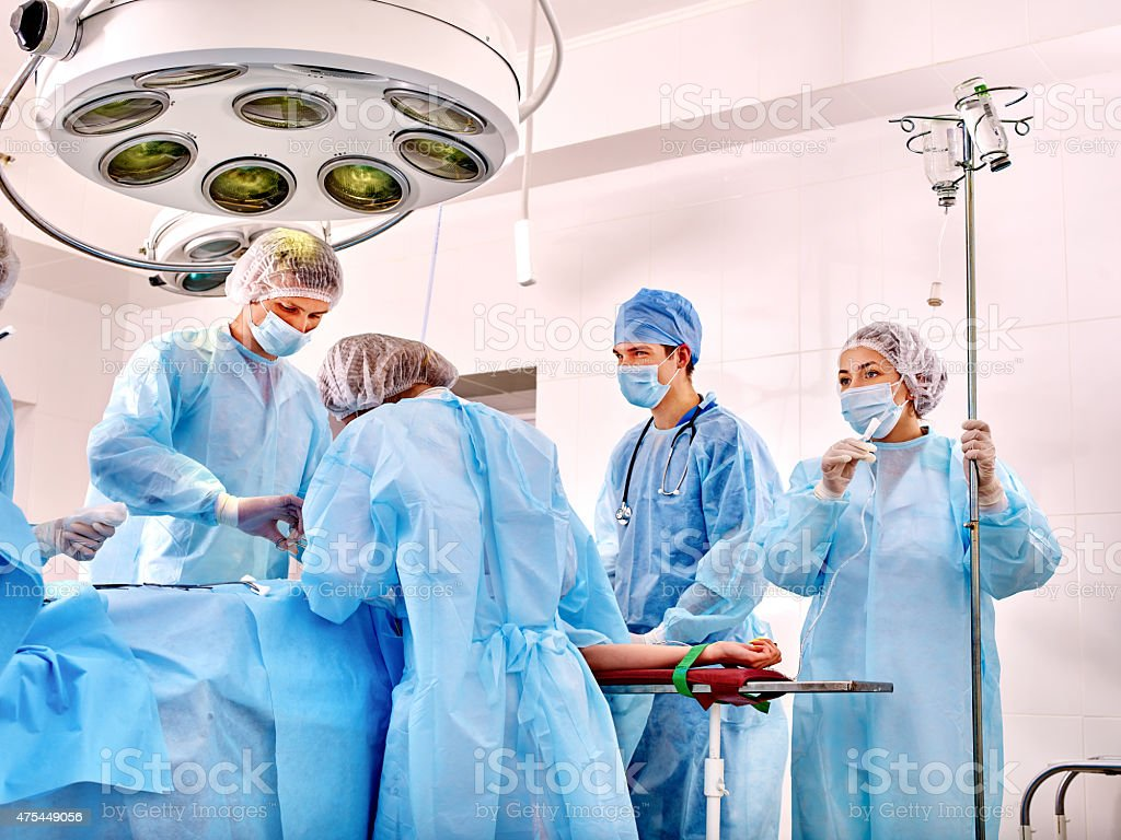 Sick patient on gurney in operating room stock photo