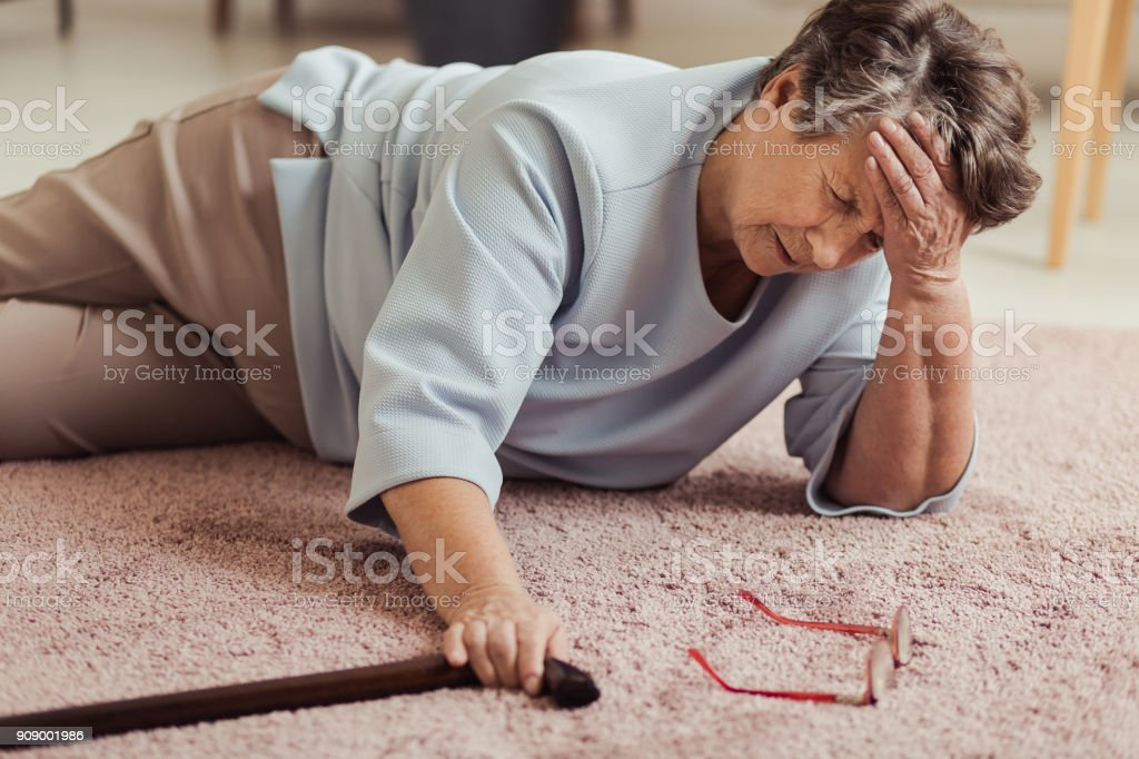 Sick senior woman with headache stock photo