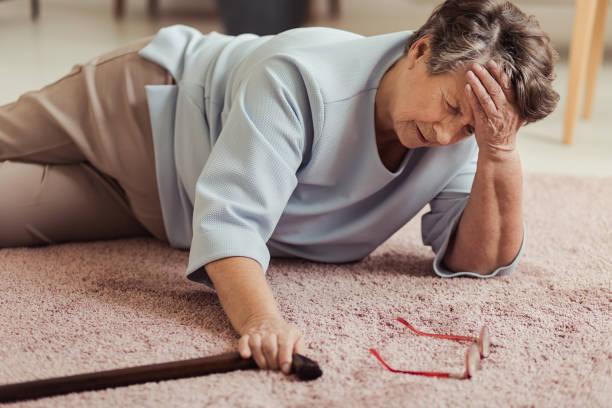 Sick senior woman with headache stock photo