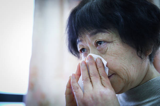 Sick senior women catch cold Sick senior women catch cold asian old woman crying stock pictures, royalty-free photos & images