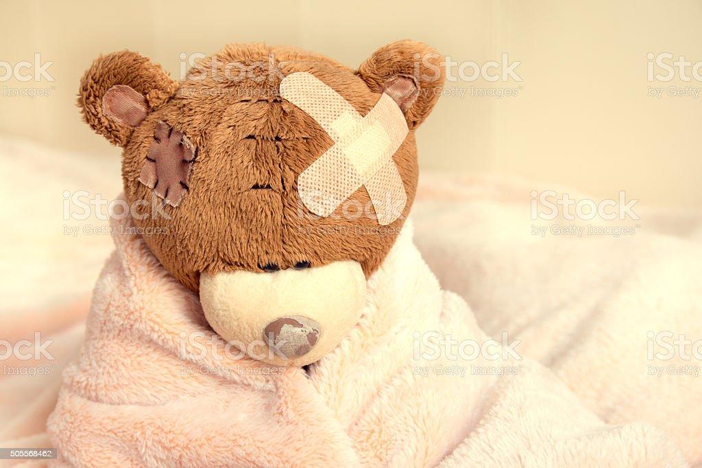 Sick teddy bear stock photo