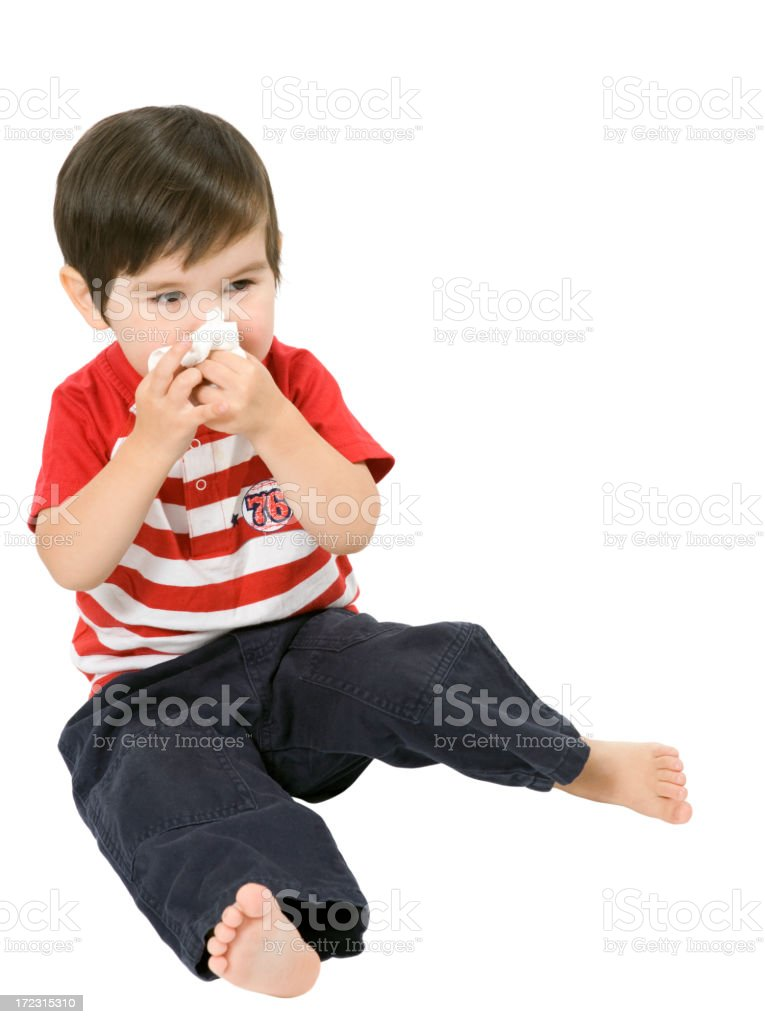 A sick toddler boy isolated on white stock photo
