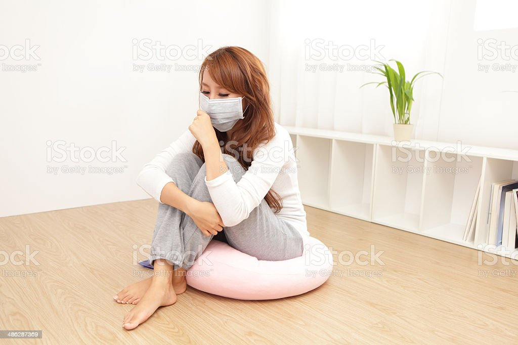 Sick Woman caught Cold and fever stock photo