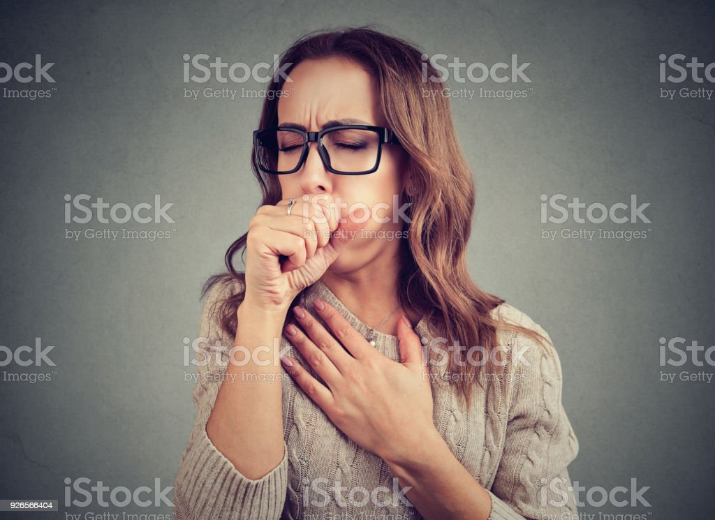 Sick woman coughing with pain stock photo