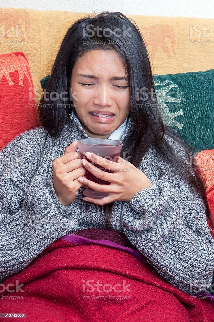 sick woman drinking tea stock photo