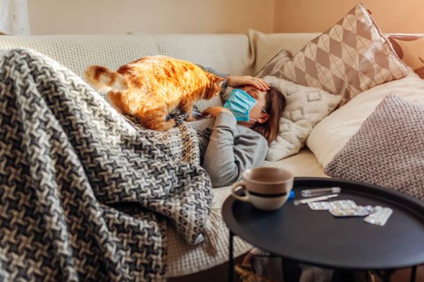 Sick woman having flu or cold girl lying in bed with cat wearing by picture id1202113925?b=1&k=6&m=1202113925&s=612x612&w=0&h=ewrbfk3ppkpngtg di8xpwnsgquyz djolkxfjvmouo=
