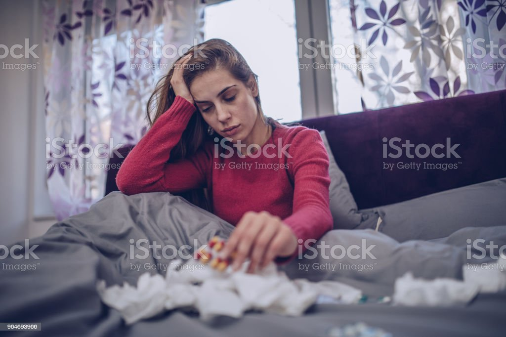 Sick woman in bed royalty-free stock photo