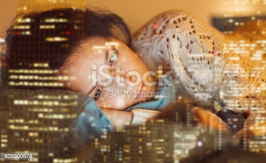 istock Sick woman in bed texting on phone 625300574