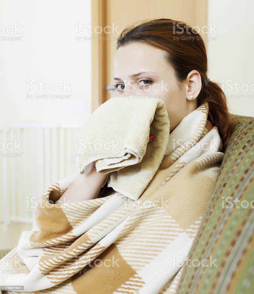 sick woman in plaid royalty-free stock photo