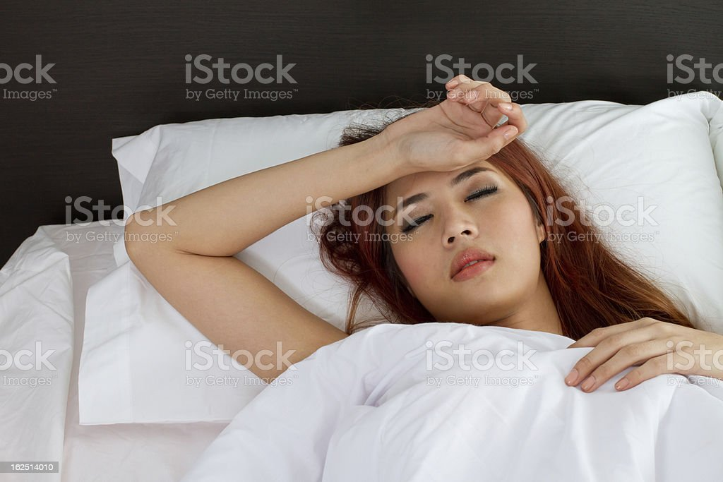 sick woman on bed royalty-free stock photo