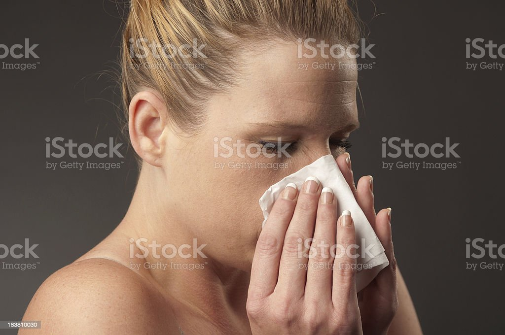 Sick Woman Sneezing stock photo