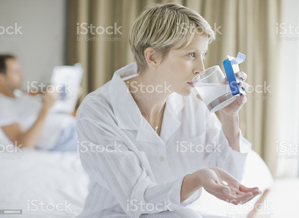 Sick woman taking antacid royalty-free stock photo