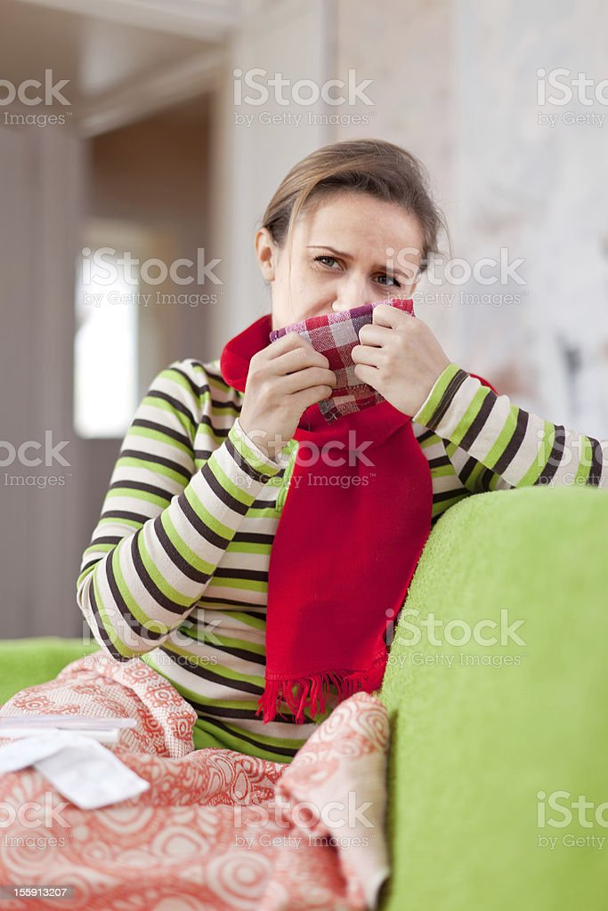 sick woman uses handkerchief stock photo