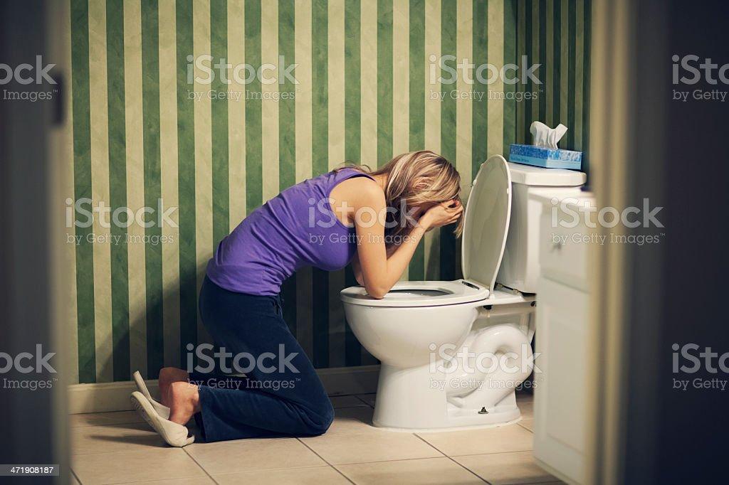 Sick woman with nausea at toilet stock photo
