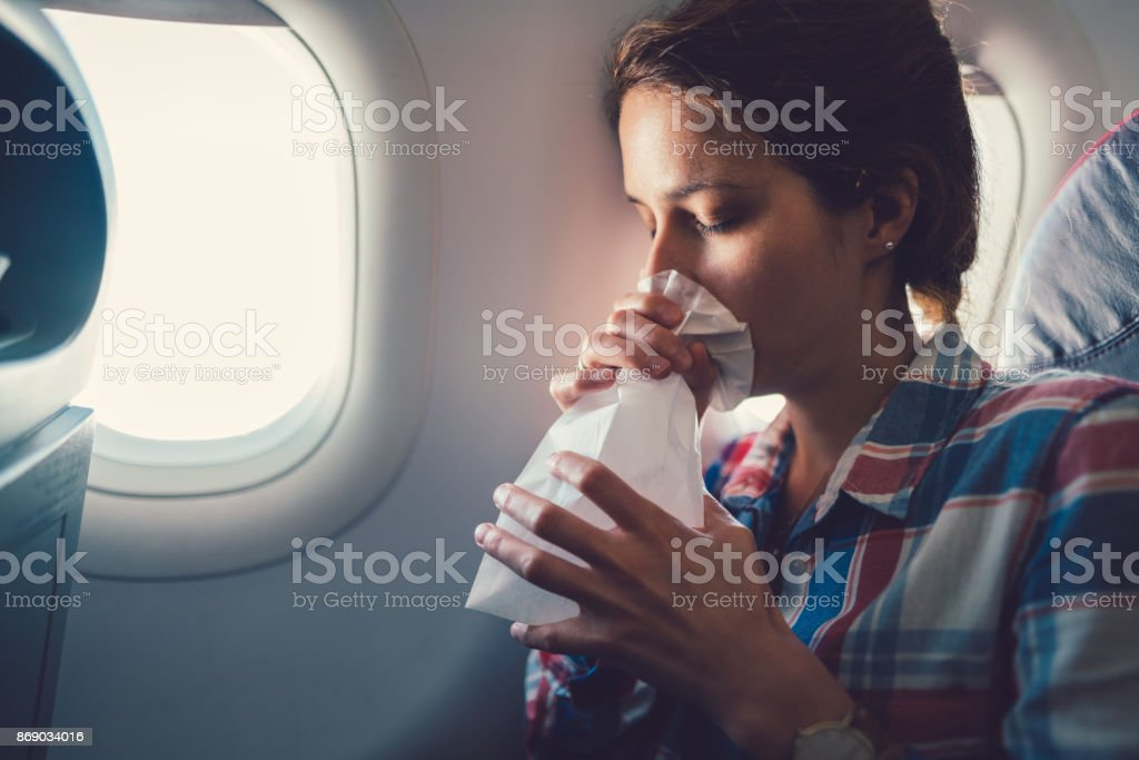 Sick woman with nausea in the airplane stock photo