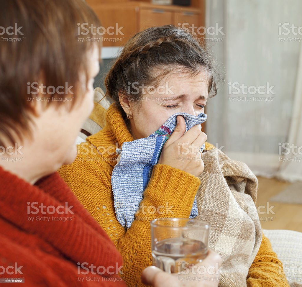 sick woman with running nose stock photo