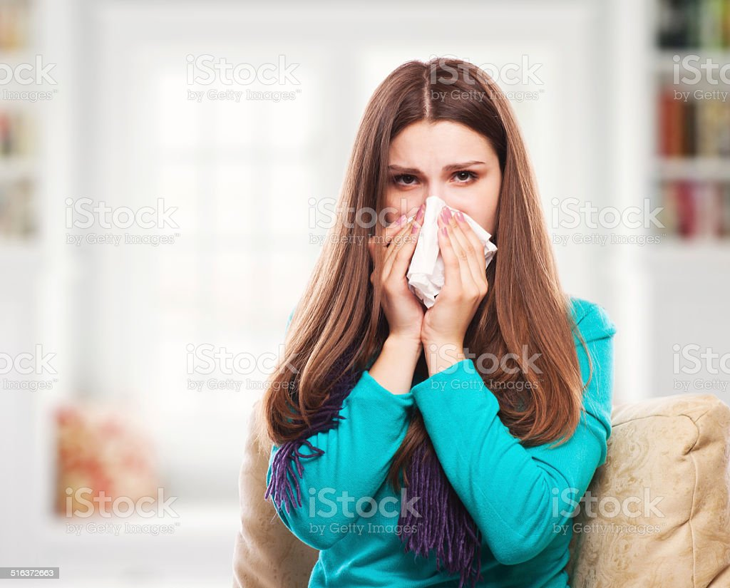Sick Woman.Flu.Woman Caught Cold. Sneezing into Tissue. Headache. stock photo