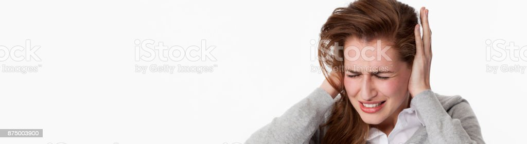 sick young woman at tinnitus or listening to loud music stock photo