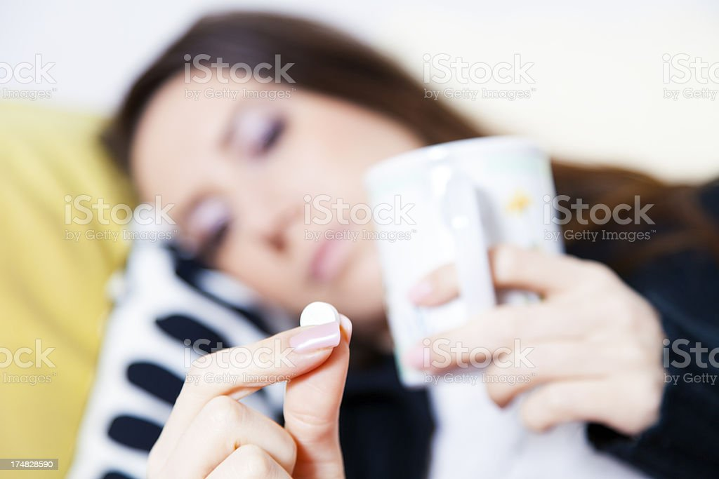 Sick young woman taking pills royalty-free stock photo