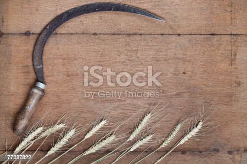 Sickle and wheat on old wooden backgroundCheck out my other backgrounds