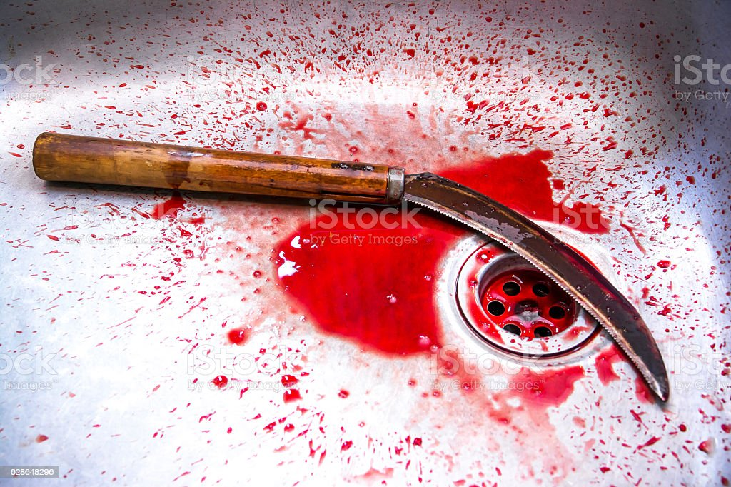 Sickle with blood at sink background,Kill concept,Murder concept stock photo