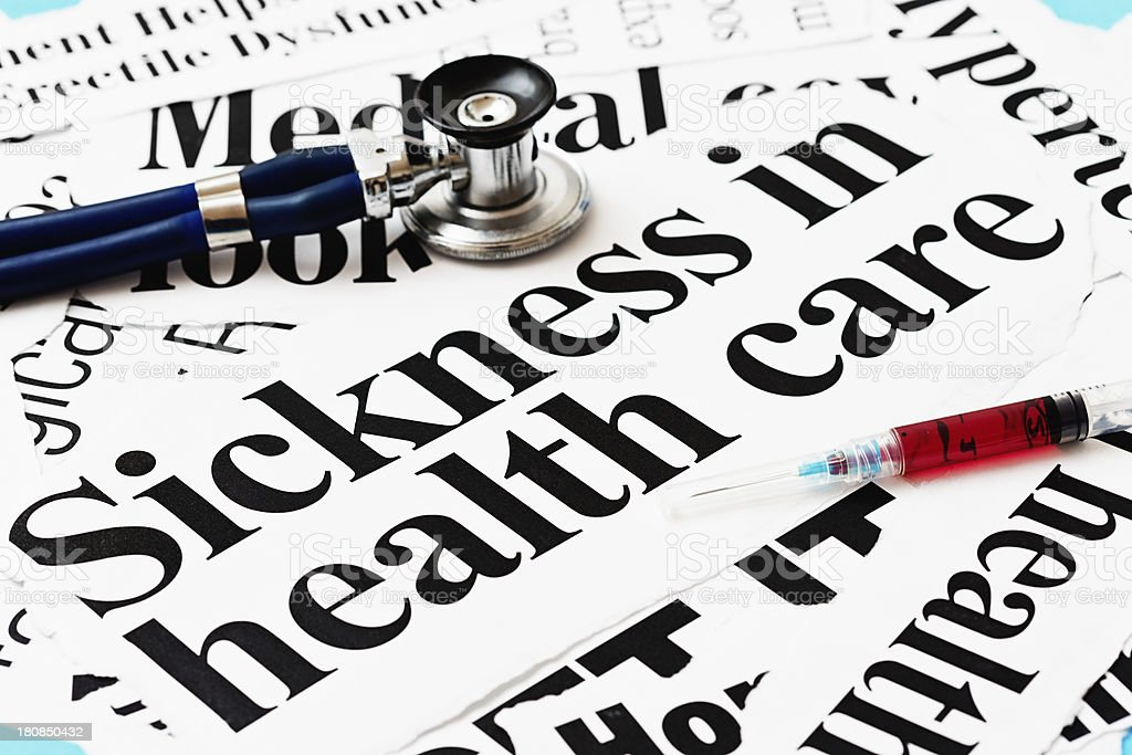Sickness in healthcare claim headlines accompanied by stethoscope and hypodermic royalty-free stock photo