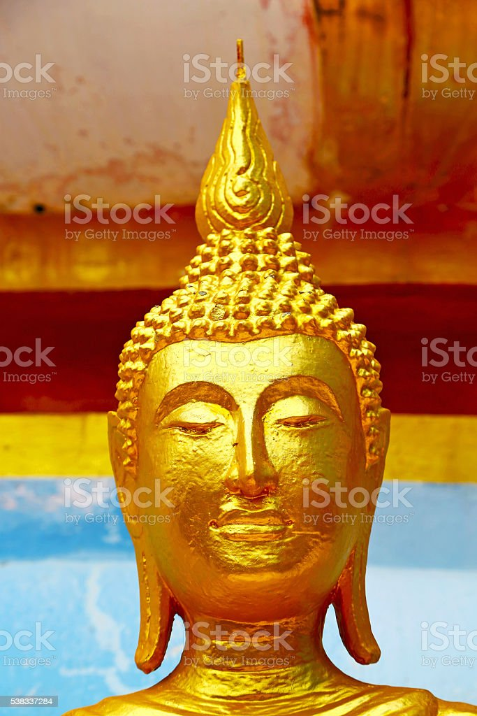 siddharta   in the temple bangkok asia  face stock photo