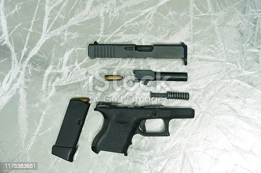 Side aspect of disassembly parts of Glock26 pistol gun