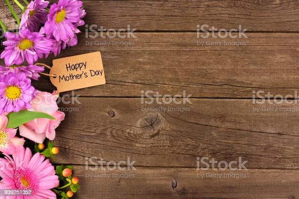 Side border of flowers with mothers day gift and tag against rustic picture id939251352?b=1&k=6&m=939251352&s=612x612&h=9k4uk2srmyntije7pv5adfir2dvnld s3fe si7xiuw=