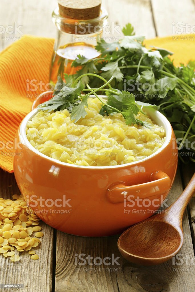 side dish of yellow lentils with herbs and spices royalty-free stock photo