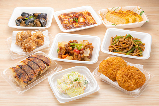 Side dishes in various packs on the table.