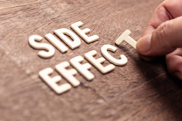 Side Effect Words Closeup hand arrange wood alphabets on the table as SIDE EFFECT word alongside stock pictures, royalty-free photos & images